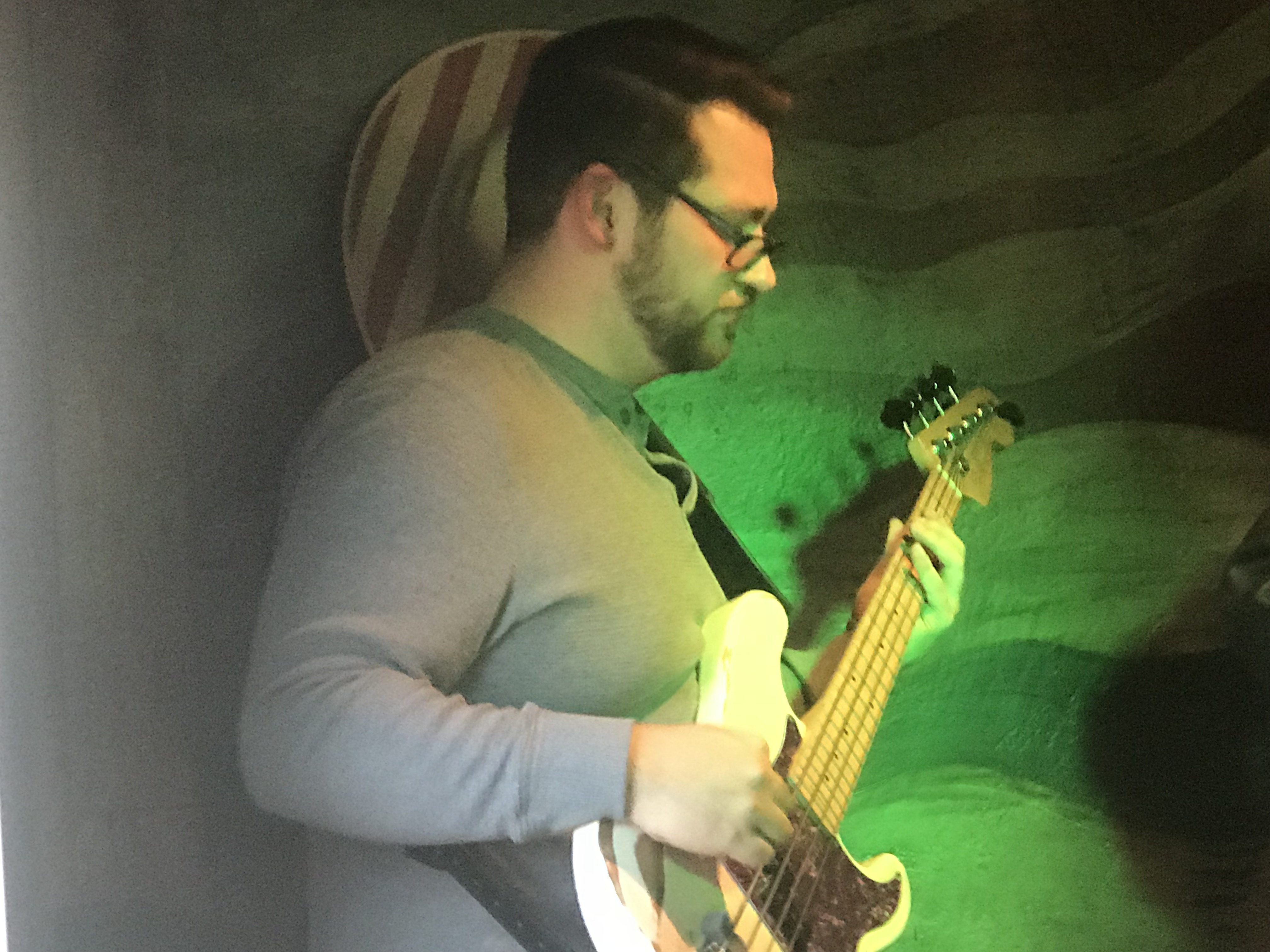 Derick playing electric bass