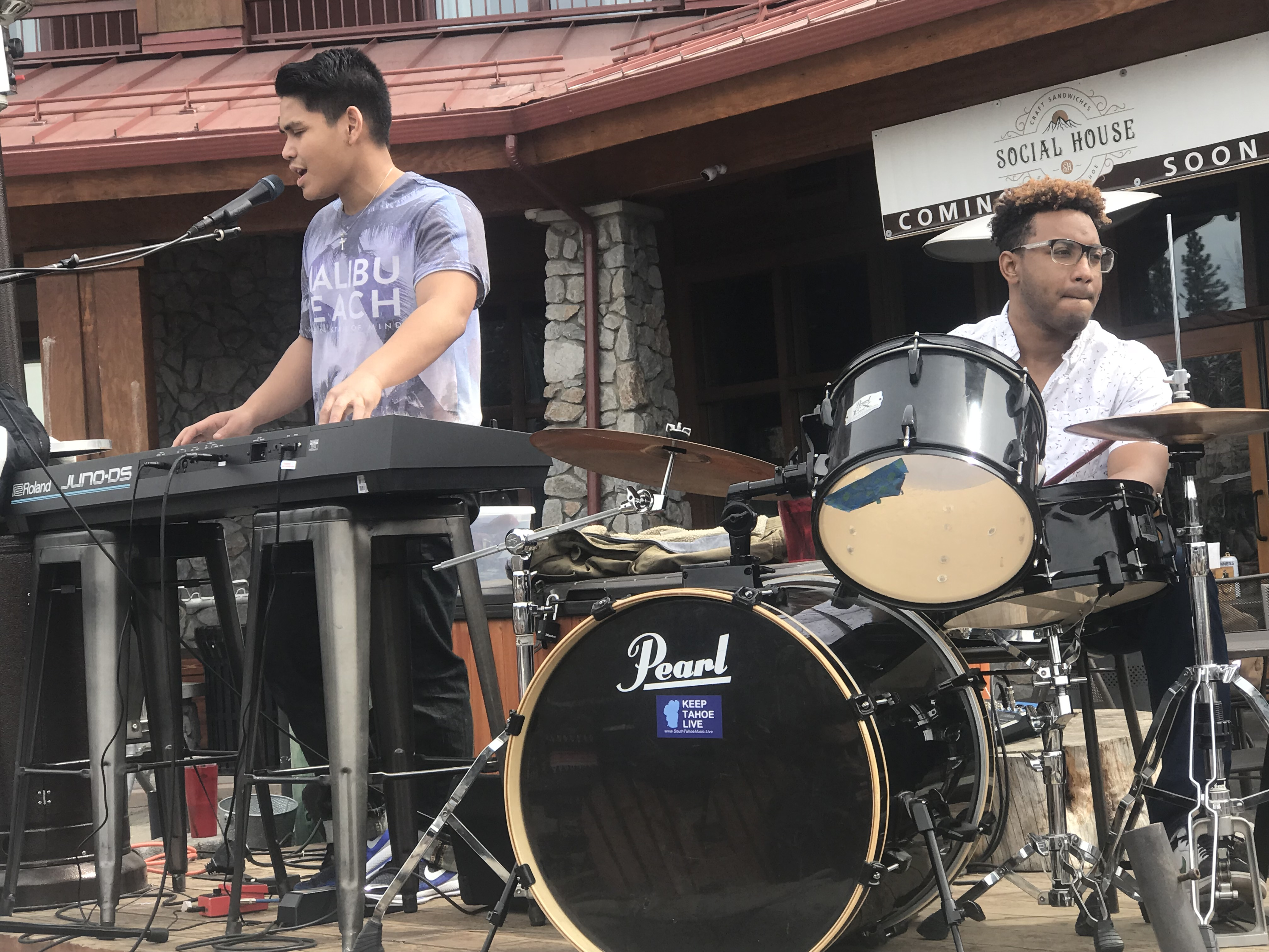 Daniel playing keyboards and Gonsin playing drums